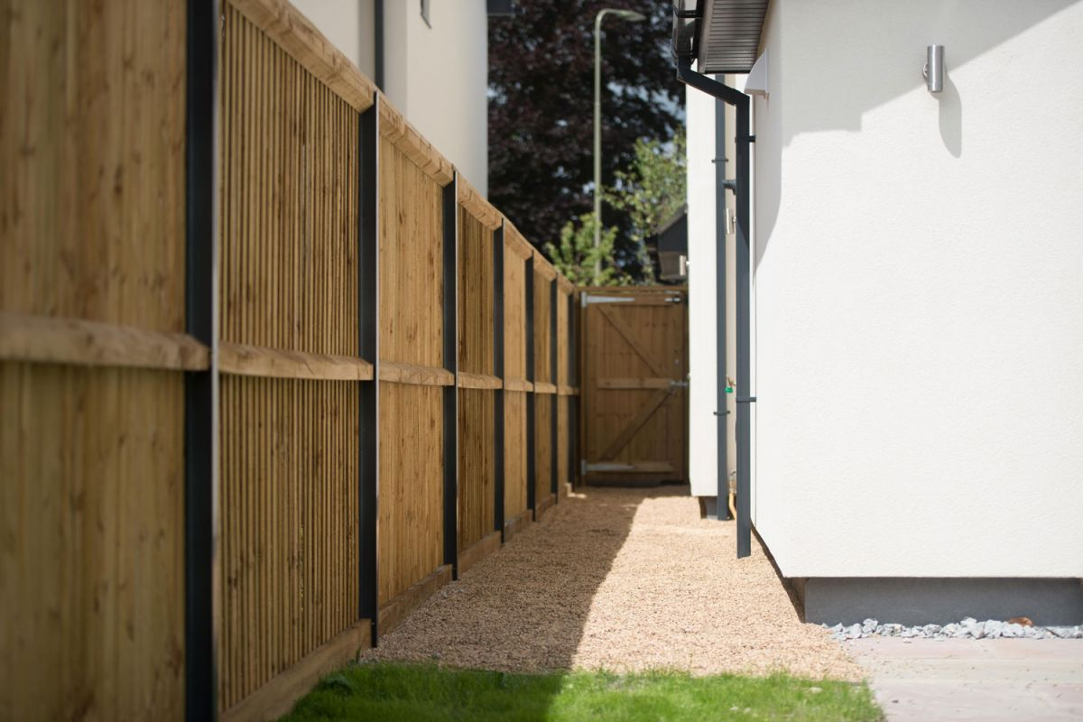 a wooden fence installed with Durapost fencing posts